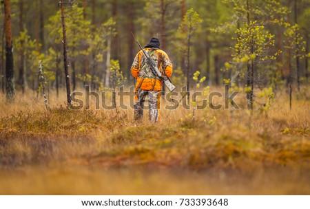 Hunter in the fall hunting season #733393648