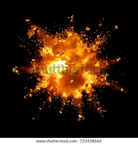 fire explosion with debris against black background Royalty-Free Stock Photo #733438666