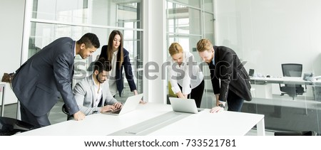 Group of businesspeople having meeting in conference room. Royalty-Free Stock Photo #733521781