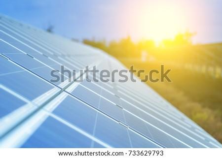 Solar panels, photovoltaic, alternative source environmentally friendly energy. In the backlight sunbeam light. #733629793