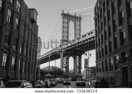 The Iconic Manhattan Bridge Viewed From Dumbo, Brooklyn, between two brick buildings with the Empire State building framed in the bottom (New York, September 2017). #733638514