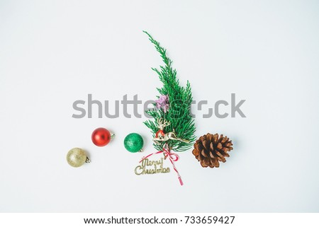 Minimalistic Christmas tree  on white background. New Year concept. Flat lay. #733659427
