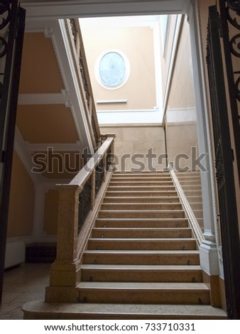Padova, Italy - May 16, 2016: Staircase in an old house in the historic city center #733710331