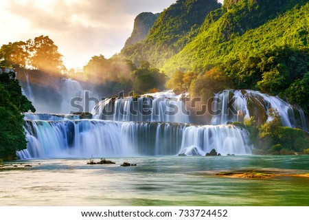 Ban Gioc waterfall in Cao Bang, Viet Nam - The waterfalls are located in an area of mature karst formations were the original limestone bedrock layers are being eroded #733724452