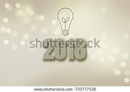 """""""2018""""wording on blurred grey  bokeh background with light bulb symbol .Creative concept. #733777528"""