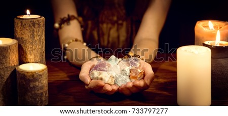 female fortune teller holding healing stones, concept esoteric and life coaching #733797277