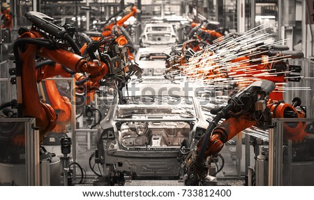 Automobile assembly line production Royalty-Free Stock Photo #733812400
