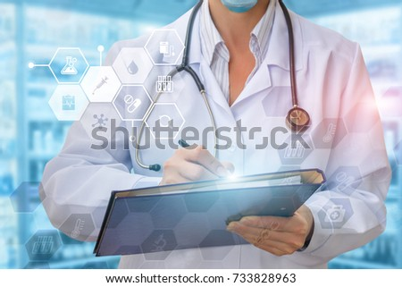 Doctor writes a prescription for blurred background. #733828963