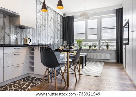 Modern small room with  kitchen area and wooden floor Royalty-Free Stock Photo #733921549