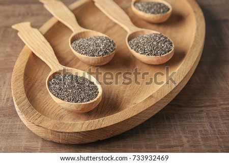 Spoons with chia seeds on wooden dish #733932469