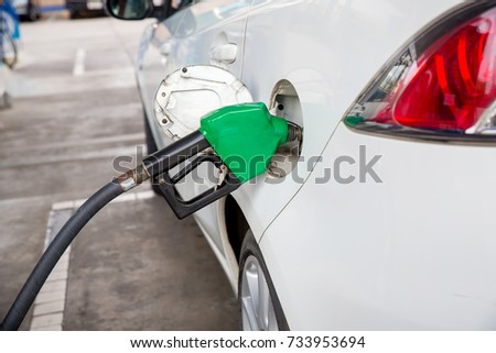 Refill and filling Oil Gas Fuel at station.  #733953694