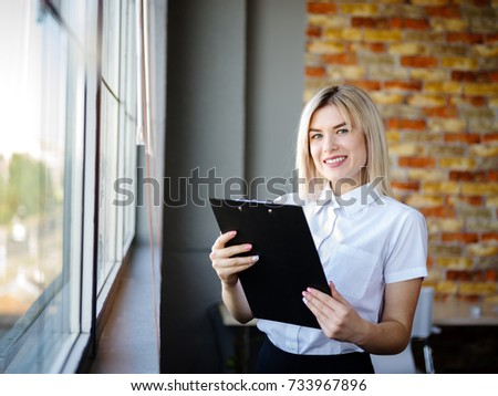 Young business woman in a white blouse with a close-up folder #733967896