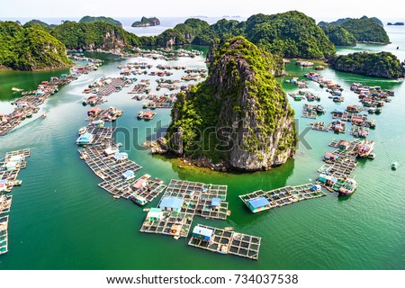 "Floating fishing village and rock island in "" Lan Ha "" Bay, Vietnam, Southeast Asia. UNESCO World Heritage Site. Landscape. Popular landmark, famous destination of Vietnam. Near "" Ha Long "" bay #734037538"