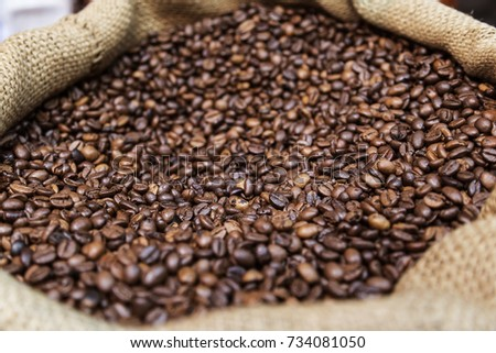 Coffee Beans in an Opened Canvas Sack #734081050