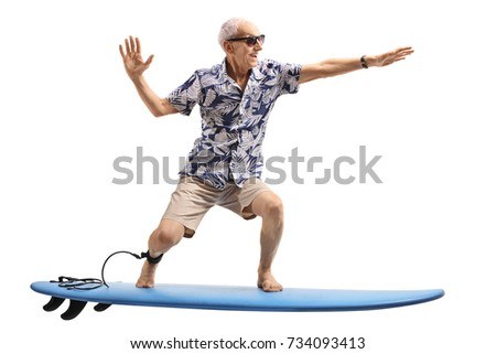 Senior surfing on a surfboard isolated on white background