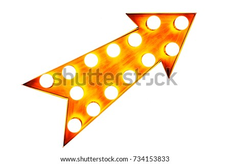 Orange, yellow and reddish color vintage bright and colorful illuminated metallic display arrow sign with glowing light bulbs isolated on a seamless white background #734153833