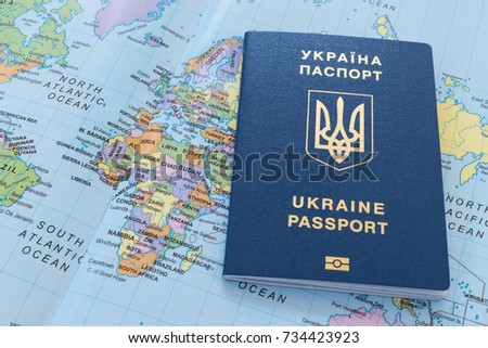 Ukrainian travel passport on a world map #734423923