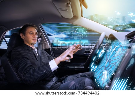 Caucasian man riding autonomous car. Self driving vehicle. Driverless car.  #734494402