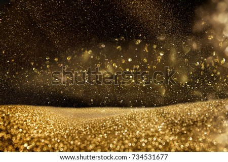 glitter vintage lights background. gold and black. de focused.