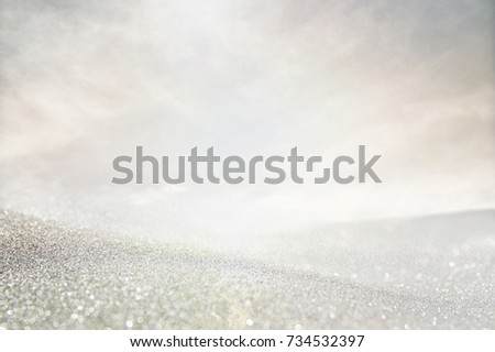 glitter vintage lights background. silver and white. de-focused. #734532397