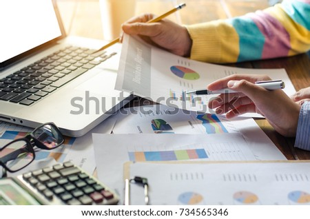 Team businessman job . working with laptop in open space office. Meeting report in progress. sun glare effect  #734565346