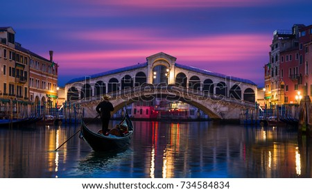 Gondola near Rialto Bridge in Venice, Italy #734584834