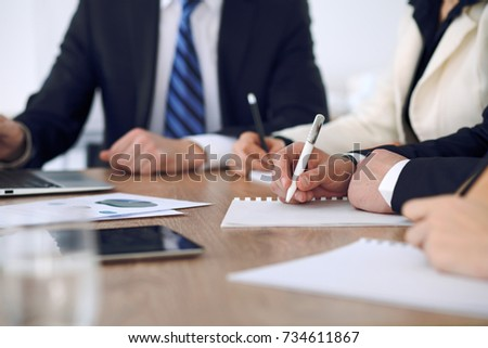 Group of business people or lawyers  at meeting, hands close-up #734611867