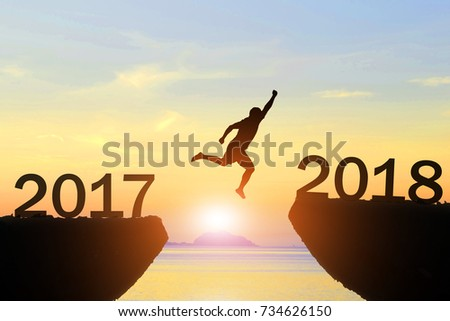 Men jump over silhouette Happy New Year 2018 #734626150