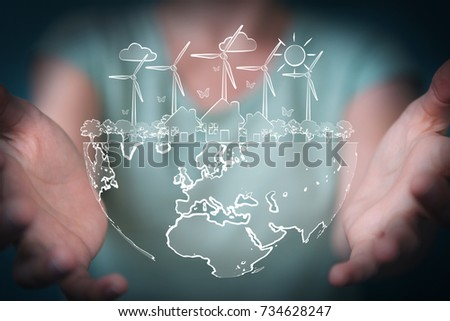 Businesswoman on blurred background touching and holding renewable energy sketch #734628247