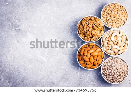 Assortment of nuts and seeds- sunflower seeds, pine nuts, cashew,walnut,almond. Top view ,space for text. #734695756