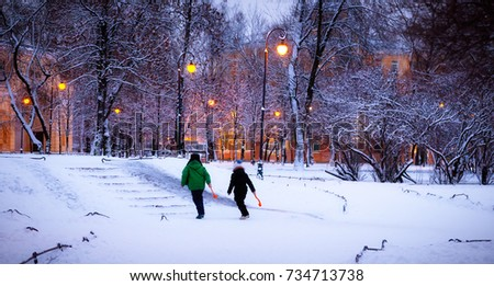 Children walk in the evening in the Park in the winter #734713738