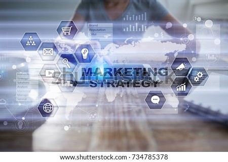 Marketing strategy concept on virtual screen. Internet, advertising and digital technology concept. Sales growth. #734785378