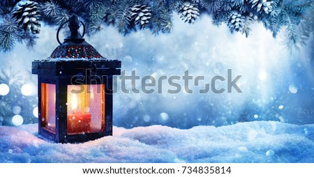 Christmas Lantern On Snow With Fir Branch In Evening Scene