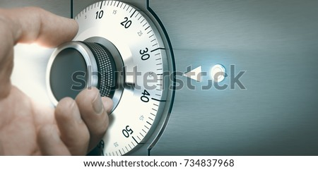 Close up of a hand unlocking a safe deposit box by turning a knob with numbers. Composite image between a hand photography and a 3D background. Royalty-Free Stock Photo #734837968