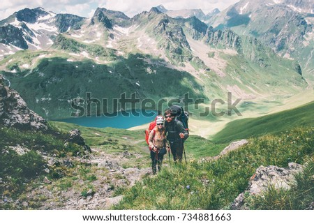 Couple travelers Man and Woman climbing in mountains Love and Travel happy emotions Lifestyle concept. Young family traveling active adventure vacations #734881663