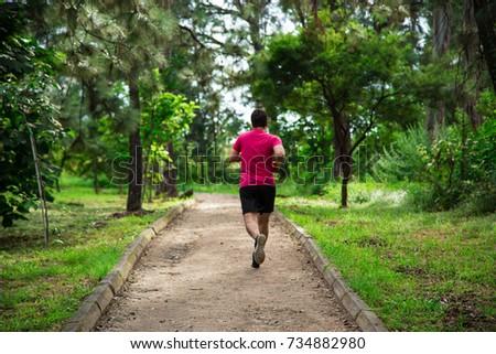 Man Running Park #734882980