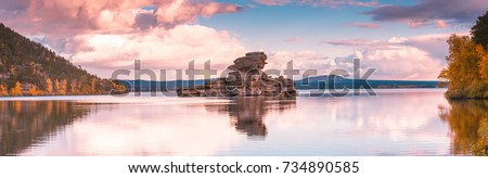 Beautiful morning landscape. Borovoe lake and stone sculprure Jumbaktas, Burabay National park in Northern Kazakhstan. Royalty-Free Stock Photo #734890585