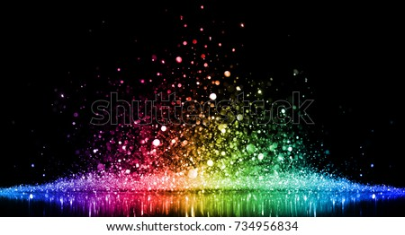 Rainbow of sparkling glittering lights abstract background Royalty-Free Stock Photo #734956834