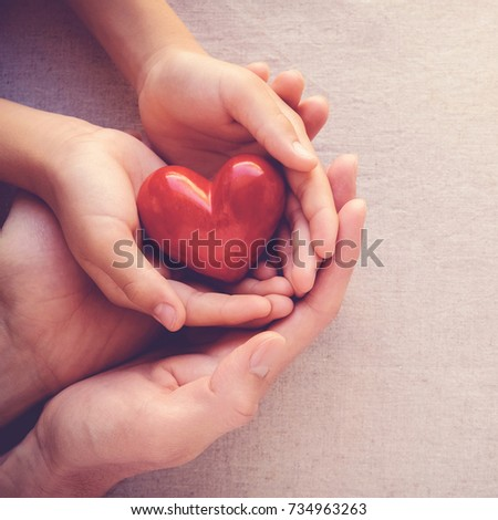 adult and child hands holding red heart, health care love and family concept, CSR responsibility, world heart day, gratitude, kind, thankful #734963263