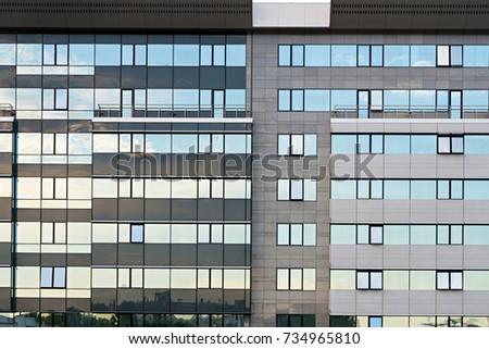 Windows on modern business building exterior #734965810