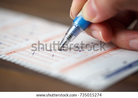 Image of person marking in lottery ticket #735015274