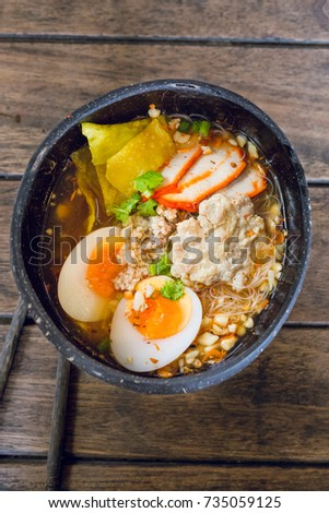 Thai traditional noodle with eggs in coconut shell  #735059125