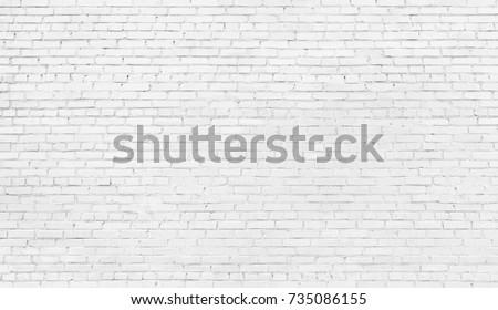 white brick wall, texture of whitened masonry as a background #735086155