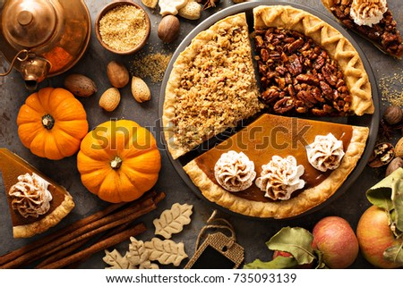 Fall traditional pies pumpkin, pecan and apple crumble pie overhead shot Royalty-Free Stock Photo #735093139