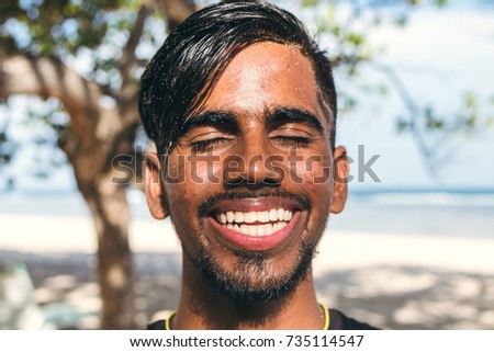 Close up portrait of young smiling asian indian yoga man outside. Park, beachside. Bali island. #735114547