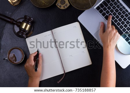 Workspace hero header with law gavel, legal book and laptop keyboard, lawyers hands typing and writting in notebook, top view flatlay lawyer background #735188857