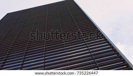 Office buildings in a business city with sunlight reflex #735226447