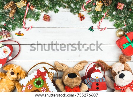 Christmas ornaments, packages with gifts, soft toys in the form of dogs on a white wooden background. Year of the dog. Space for text #735276607