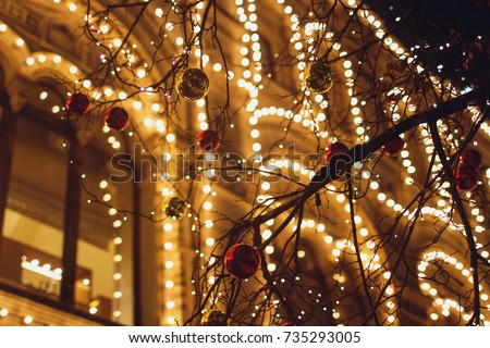 Christmas decorations on the street, colorful holiday bokeh lights, city night illumination, abstract blurry festive background #735293005