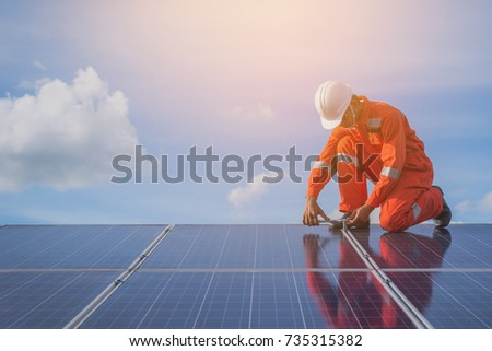 operation and maintenance in solar power plant ; engineer working on checking and maintenance in solar power plant ,solar power plant to innovation of green energy for life  #735315382